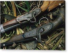 A Pair Of Old Flint-type Rifles Lying Acrylic Print by Steve Winter