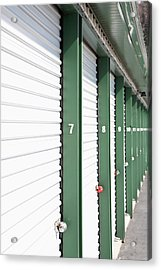 A Row Of Locked Storage Units At A Self Storage Facility Acrylic Print by Frederick Bass