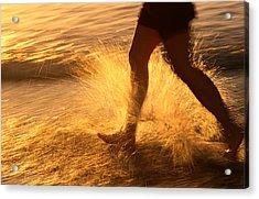 A Runner Splashing Through The Surf Acrylic Print by Phil Schermeister