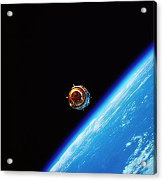 A Satellite In Orbit Above Earth Acrylic Print by Stockbyte