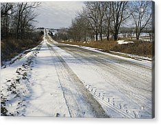 A Snow-covered Road Passes Acrylic Print by Joel Sartore