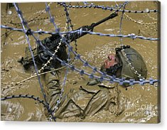 A Soldier Back Crawls Through A Pit Acrylic Print by Stocktrek Images