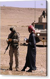 A Soldier Communicates With A Local Acrylic Print by Stocktrek Images