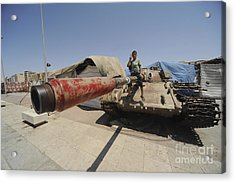 A T-55 Tank With Two Children Playing Acrylic Print by Andrew Chittock