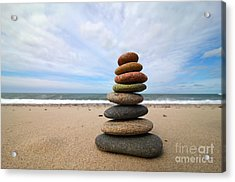 A Tower Of Stones On The Beach Acrylic Print by Holger Ostwald