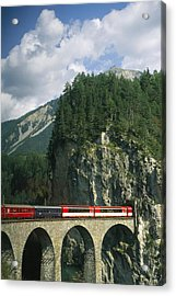 A Train Passes Into A Acrylic Print by Taylor S. Kennedy