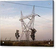 A Transmission Tower Carrying Electric Lines In The Countryside Acrylic Print by Ashish Agarwal