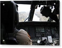 A Uh-60 Blackhawk Flies The River To An Acrylic Print by Terry Moore
