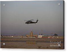 A Uh-60 Blackhawk Helicopter Flies Acrylic Print by Terry Moore
