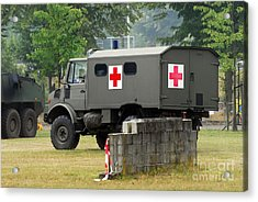 A Unimog In An Ambulance Version In Use Acrylic Print by Luc De Jaeger