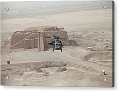 A Us Army Black Hawk Helicopter Hovers Acrylic Print by Everett