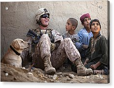 A U.s. Marine Jokes With Afghan Acrylic Print by Stocktrek Images