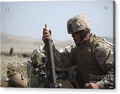 A U.s. Marine Loads A Mortar Acrylic Print by Stocktrek Images