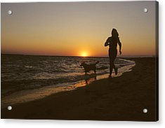 A Woman And Her Dog Running Acrylic Print by Skip Brown
