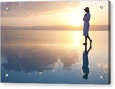 A Woman Enjoys The Warm Sun On The Edge Acrylic Print by Taylor S. Kennedy