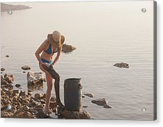 A Woman Smears Therapeutic Dead Sea Mud Acrylic Print by Taylor S. Kennedy