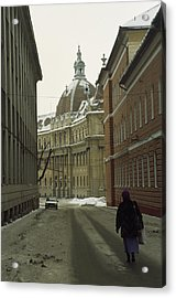 A Woman Walks Down A Snowy  Street Acrylic Print by Gordon Wiltsie