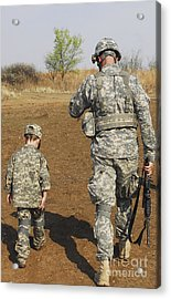 A Young Boy Joins His Squad Leader Acrylic Print by Stocktrek Images