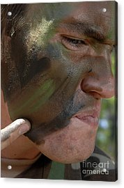 Airman Applies War Paint To His Face Acrylic Print by Stocktrek Images