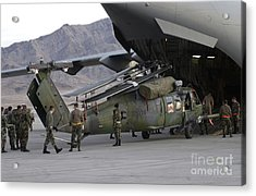 Airmen Load An Hh-60 Pave Hawk Acrylic Print by Stocktrek Images