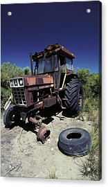 An Abandoned Tractor Rusts Away Acrylic Print by Jason Edwards
