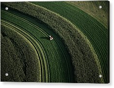 An Aerial View Of A Tractor On Curved Acrylic Print by Paul Chesley