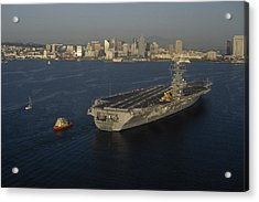 An Aircraft Carrier With The Skyline Acrylic Print by Phil Schermeister