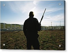 An Armed Guard Watches Over Inmates Acrylic Print by Bill Curtsinger