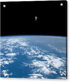 An Astronaut Propelled Above The Earth Acrylic Print by Nasa