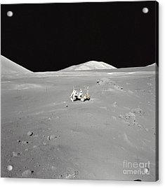 An Astronaut Working At The Lunar Acrylic Print by Stocktrek Images