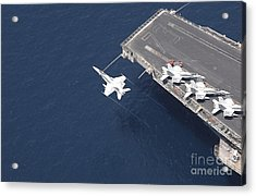 An Fa-18 Hornet Flys Over Aircraft Acrylic Print by Stocktrek Images