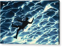 An Ice Climber Crosses The Ceiling Acrylic Print by Carsten Peter