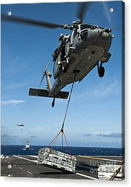 An Mh-60s Sea Hawk Helicopter Lowers Acrylic Print by Stocktrek Images