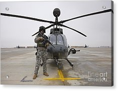 An Oh-58d Kiowa Warrior Pilot Stands Acrylic Print by Terry Moore