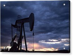 An Oil Rig Silhouetted At Sunset Acrylic Print by Joel Sartore