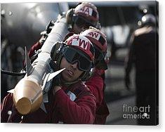 Aviation Ordnancemen Carry An Acrylic Print by Stocktrek Images