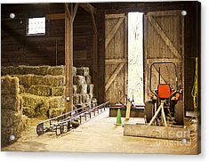 Barn With Hay Bales And Farm Equipment Acrylic Print by Elena Elisseeva