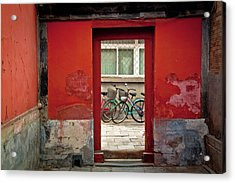 Bicycles In Red Doorway Acrylic Print by photo by Sharon Drummond