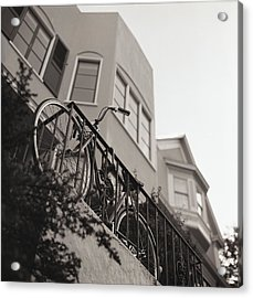 Bike Locked On Fence Against House Acrylic Print by Copyright Ricky G. Brown 2011