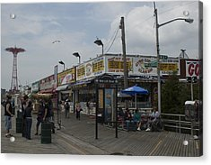 Boardwalk At Coney Island On A Cloudy Acrylic Print by Todd Gipstein