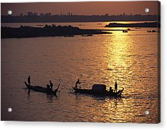 Boats Silhouetted On The Mekong River Acrylic Print by Steve Raymer