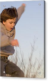 Boy Jumping Off Sand Dune Acrylic Print by Christopher Purcell