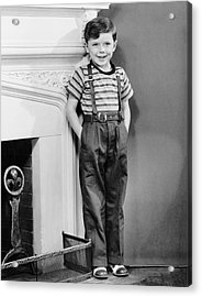 Boy Leaning Against Wall By Fireplace Acrylic Print by George Marks