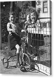 Boy On Tricycle W/ Girl Acrylic Print by George Marks