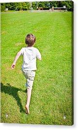 Boy Running Acrylic Print by Tom Gowanlock