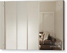 Brown Leather Sofa Seen Through Open Door Acrylic Print by Andersen Ross