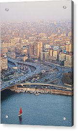 Busy Junction And The Nile With Traditional Boat Acrylic Print by Kokoroimages.com
