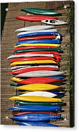 Canoes On A Dock Acrylic Print by Susan Isakson