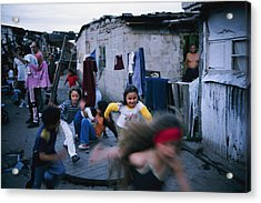 Children Play Around An Abandoned Acrylic Print by Pablo Corral Vega