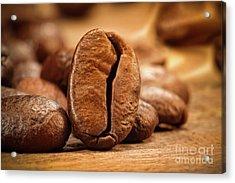 Closeup Shot Of A Coffee Bean On Wood Acrylic Print by Sandra Cunningham